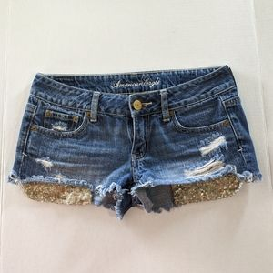 American Eagle gold sequin pocket jean shorts